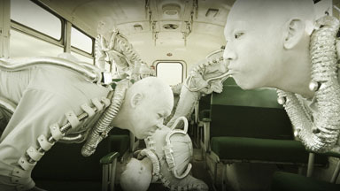 The Core Units sniff for clues in a ditched bus. (21k image)